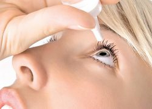 An eye drop is one of the common treatment modalities for eye infection like iridocyclitis image picture photo