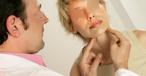 The doctor is performing a physical examination on the patient's neck area image photo picture